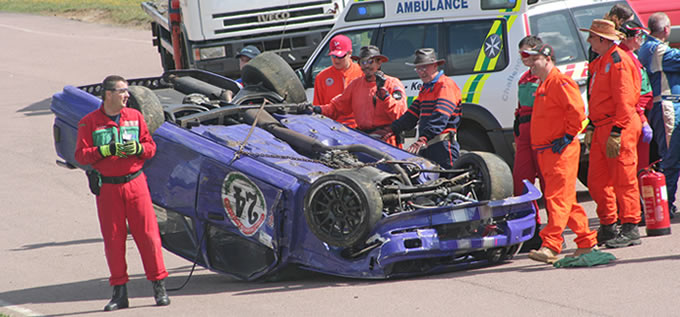 Marshals attend an accident at Lydden Circuit