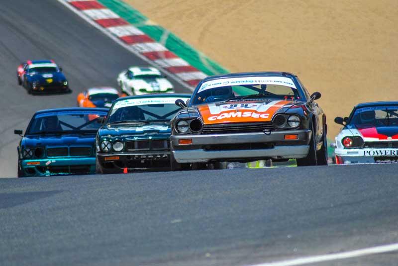 Jaguar racing cars in action